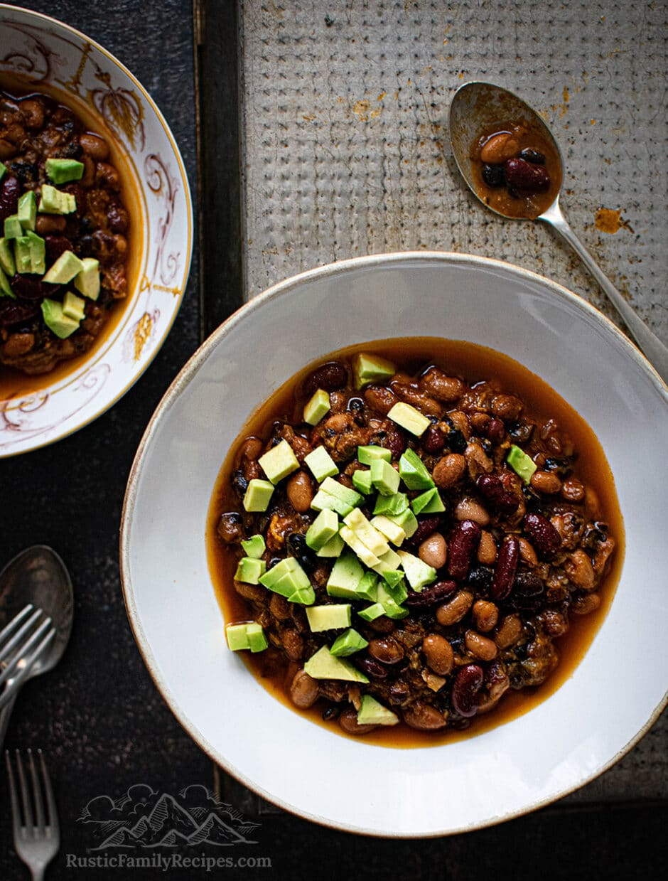 Two white bowls with 3 bean sweet potato chili