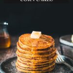 Stack of pumpkin johnnycakes with butter and syrup