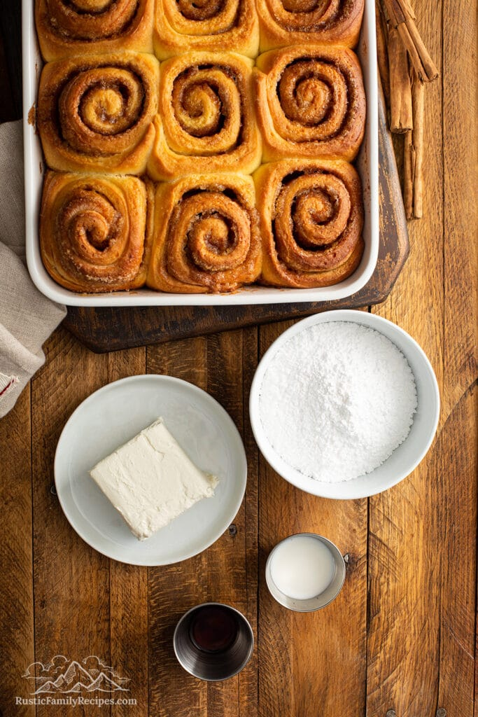 Baked cinnamon rolls ready to be frosted.