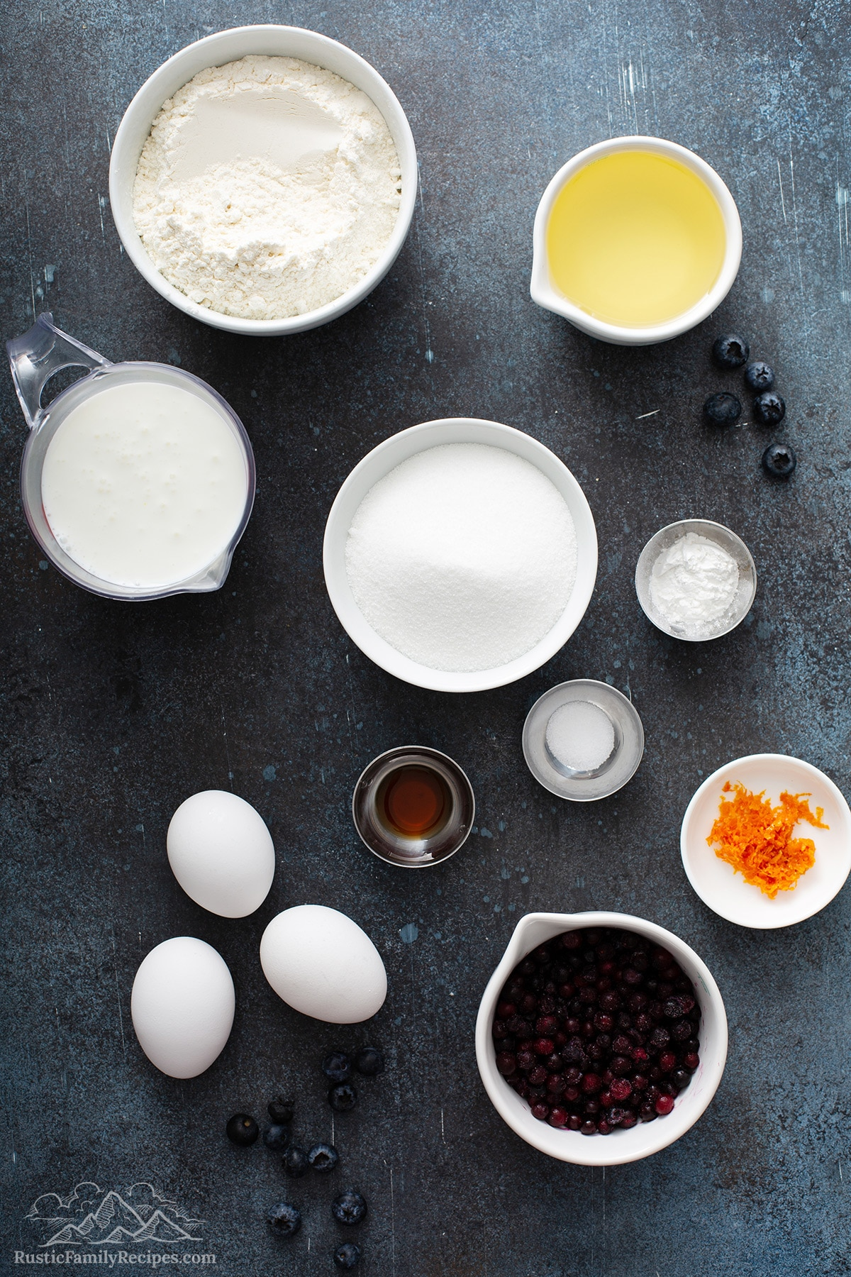 Bowls on a grey background with coffee cake ingredients.