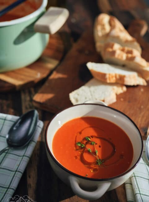 Bowl of tomato soup with olive oil.