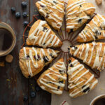Glazed blueberry scones on a cooling rack