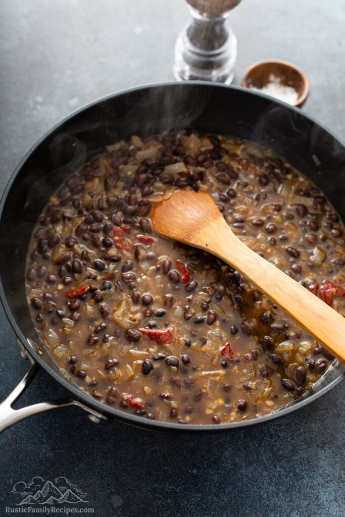 Beans, onion and chipotle cooking in a pan