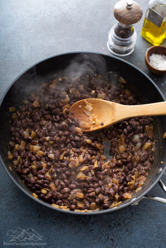 Black beans in a frying pan.