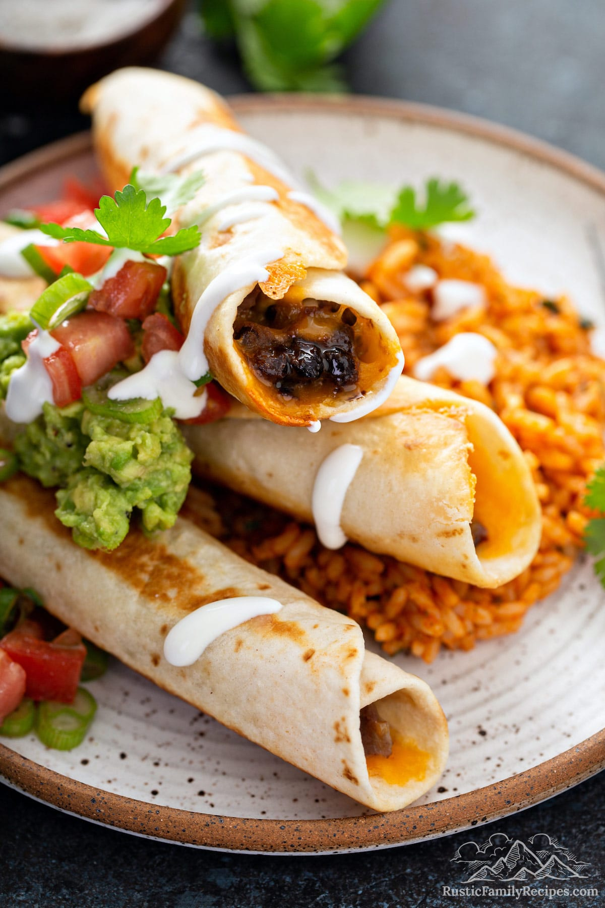 Plate of black bean flautas with Mexican rice.