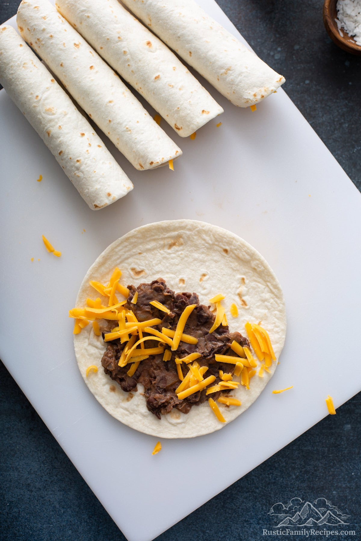 Flour tortillas with mashed beans and cheese.