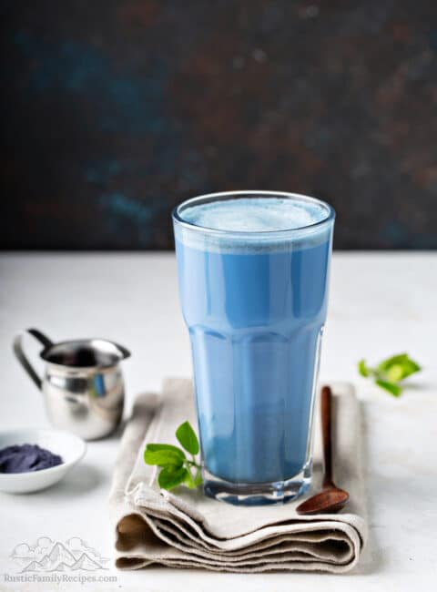 A tall glass with blue matcha latte