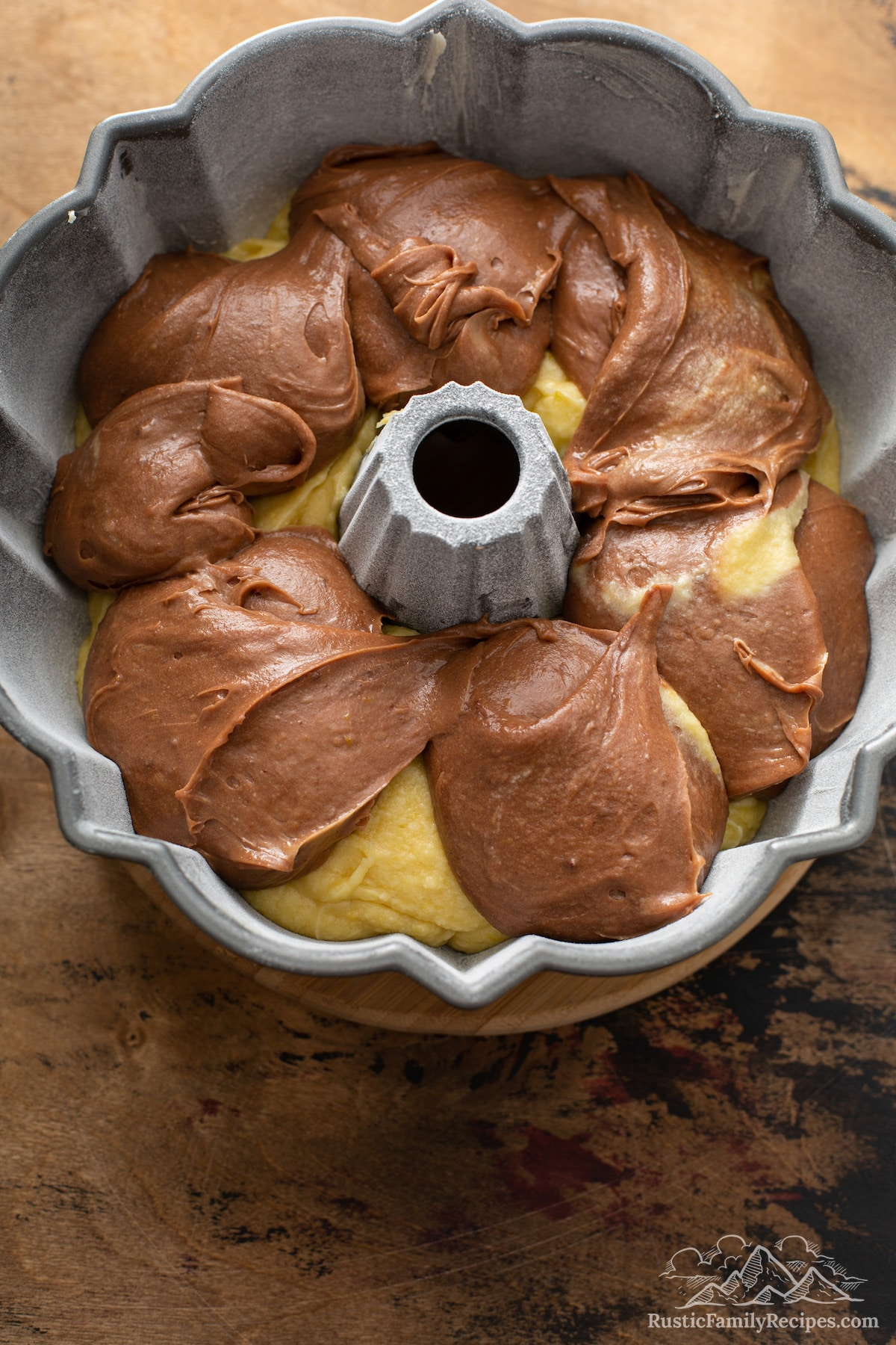 Chocolate and vanilla batter in a bundt pan.
