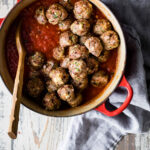 Turkey meatballs in a dutch oven with pasta sauce