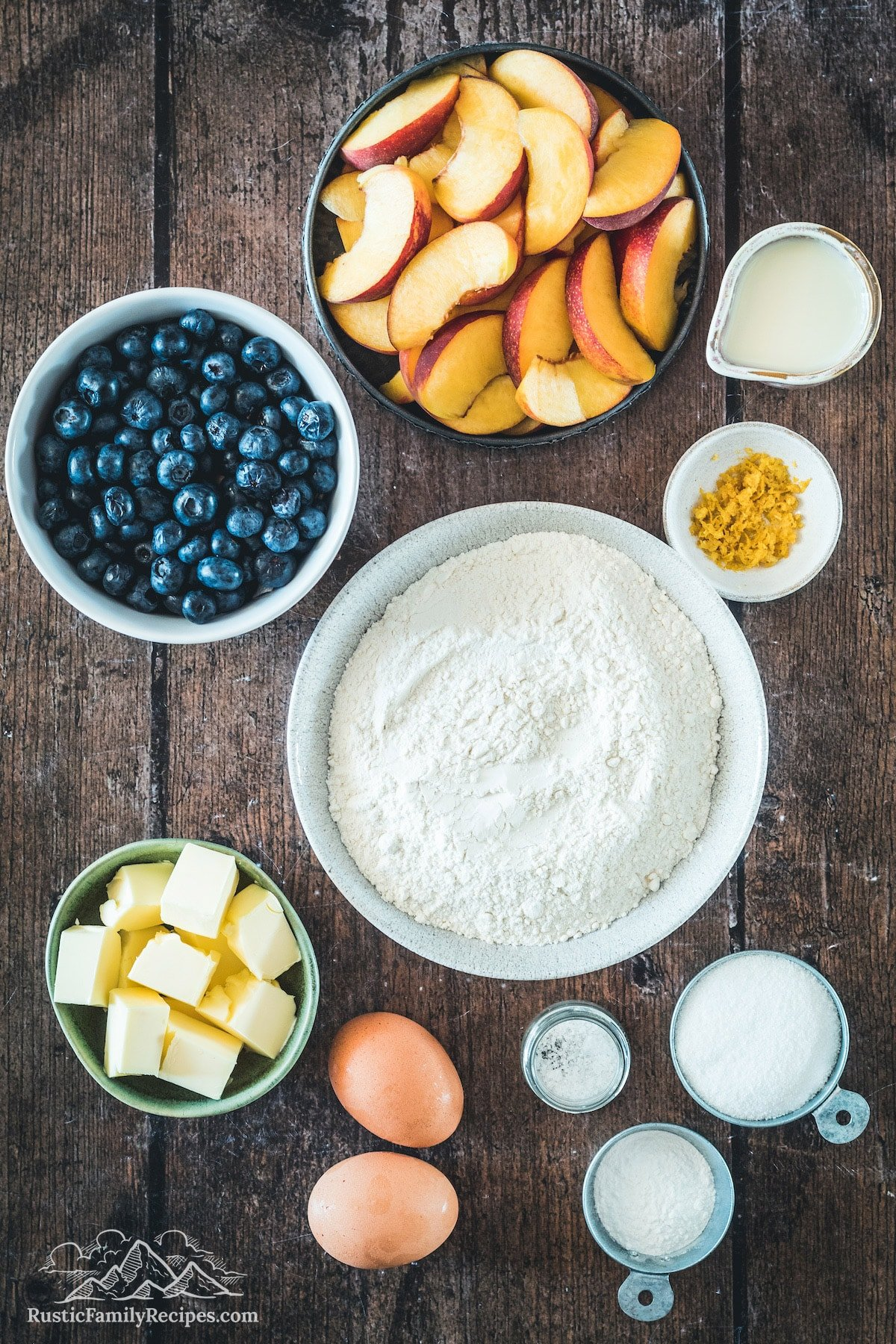 Ingredients for blueberry peach cobbler in bowls