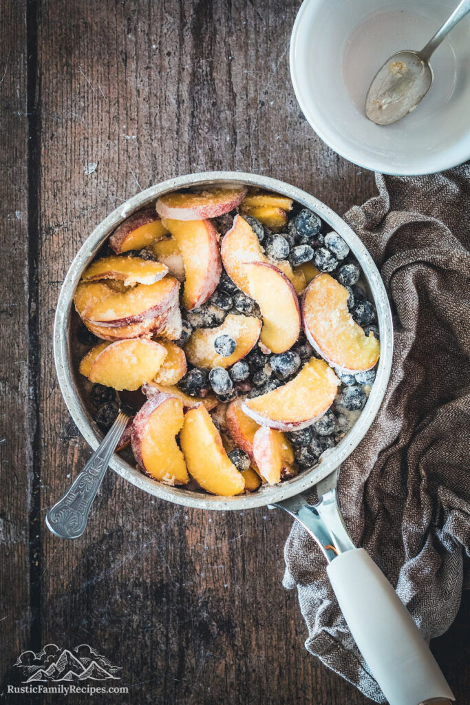 Fresh blueberries and peaches tossed with sugar and flour