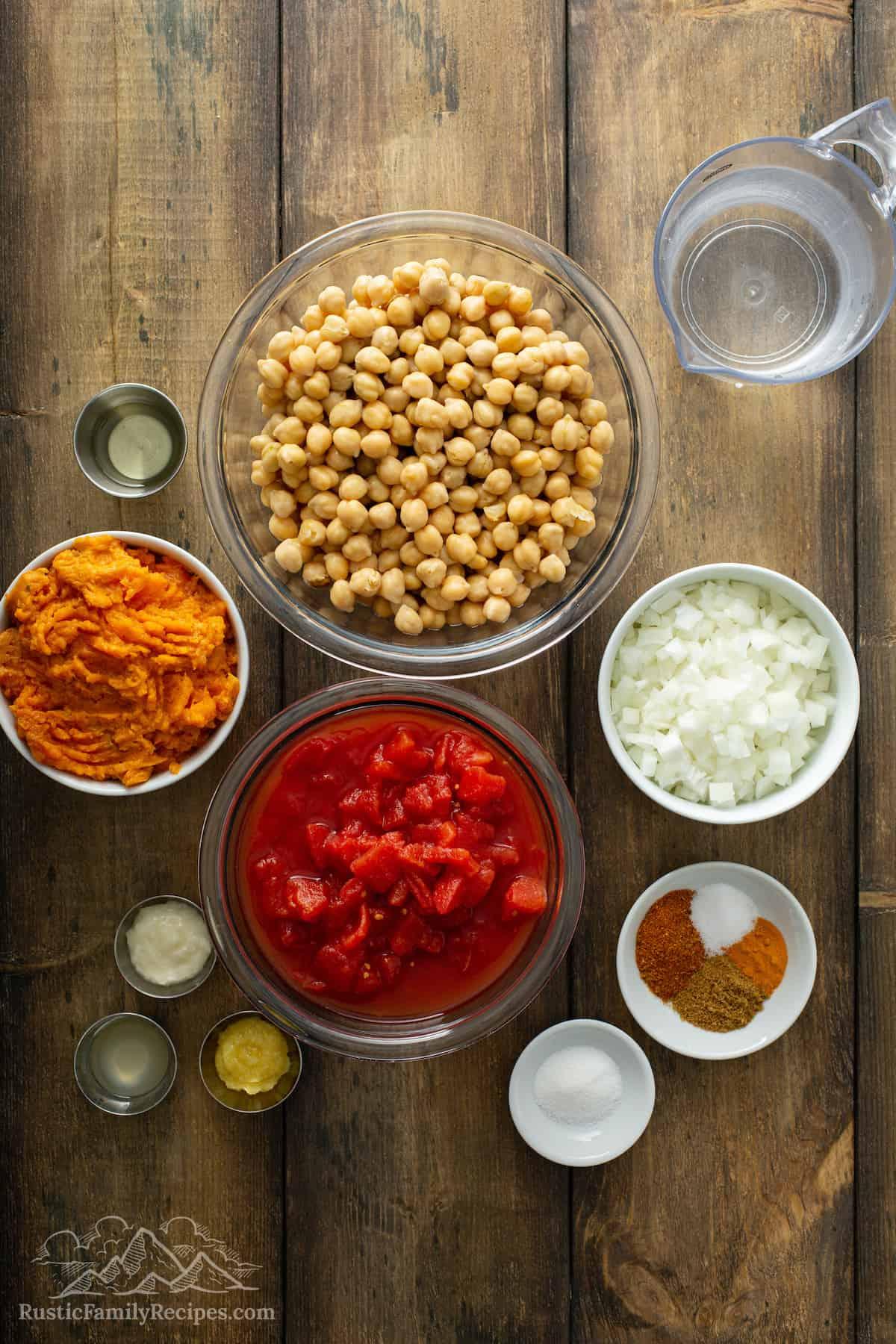 Ingredients for Instant Pot Sweet Potato Chickpea Masala: sweet potato, olive oil, water, chickpeas, onion, diced tomato, lemon juice, cumin, turmeric, garam masala, kosher salt, white sugar, ginger paste, and garlic cloves.