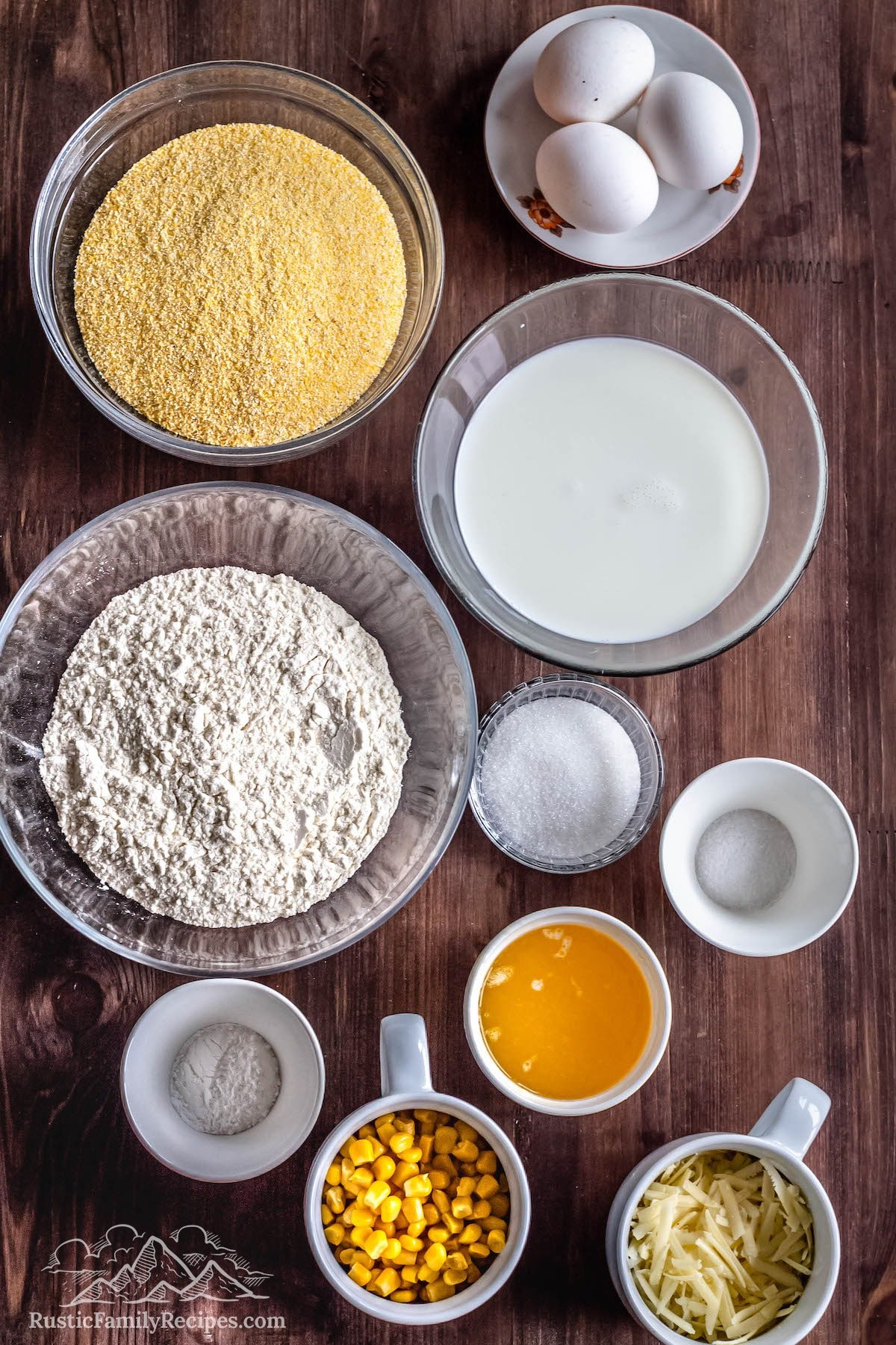The ingredients needed to make Easy Cheddar Cornbread. This includes: Butter, Eggs, Half-and-Half or Whole Milk, Fine Yellow Cornmeal, Unbleached All-Purpose Flour, Salt, Baking Powder, Sugar, Fresh, Frozen and Thawed, or Canned Corn Kernels, and Freshly Grated Sharp Cheddar Cheese.