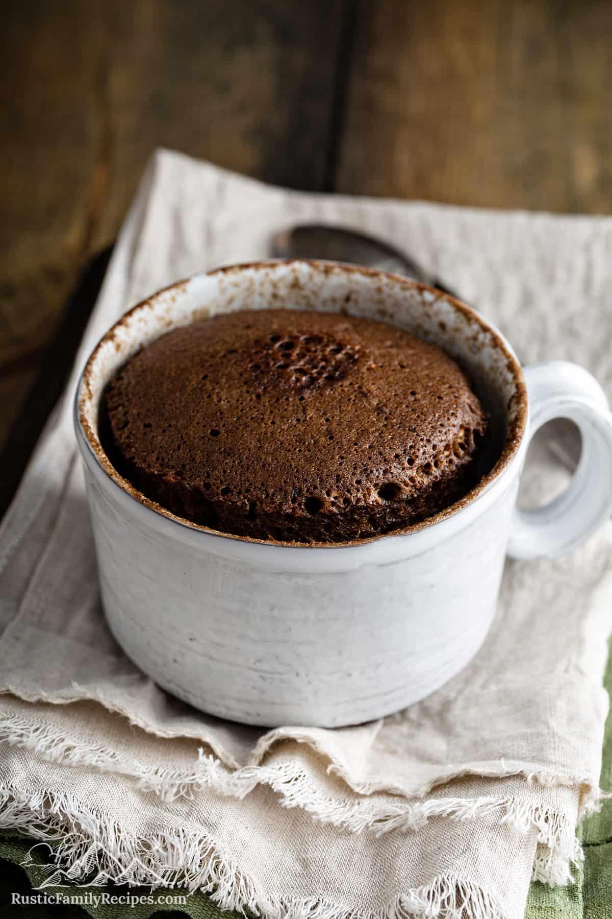 A mug filled with nutella mug cake
