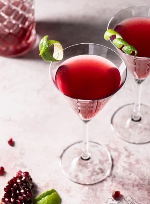 A martini glass with pomegranate maple cosmopolitan