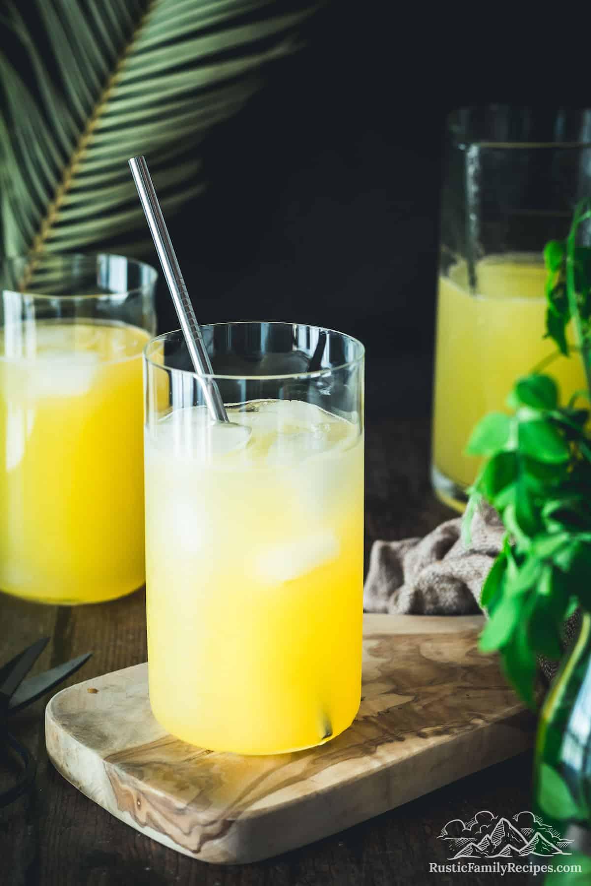 Three glasses of mango lemonade with ice