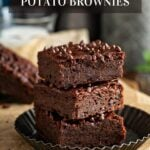 Three vegan sweet potato brownies stacked on a plate