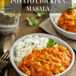 Two bowls of Instant Pot Sweet Potato Chickpea Masala with rice, a fork, and water.