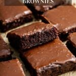 A stack of zucchini brownies on parchment paper