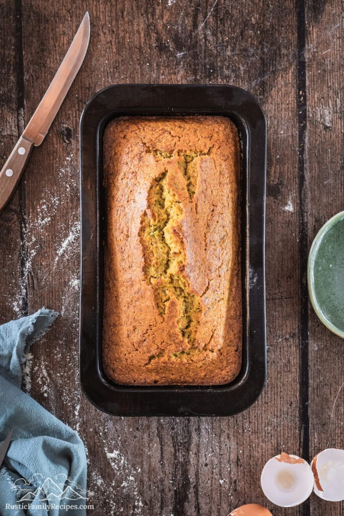The prepared pan with the cooked golden zucchini cornbread.