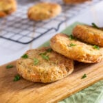 Fried green tomatoes on a wood cutting board
