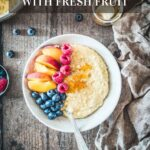 A bowl of millet porridge topped with fresh fruit