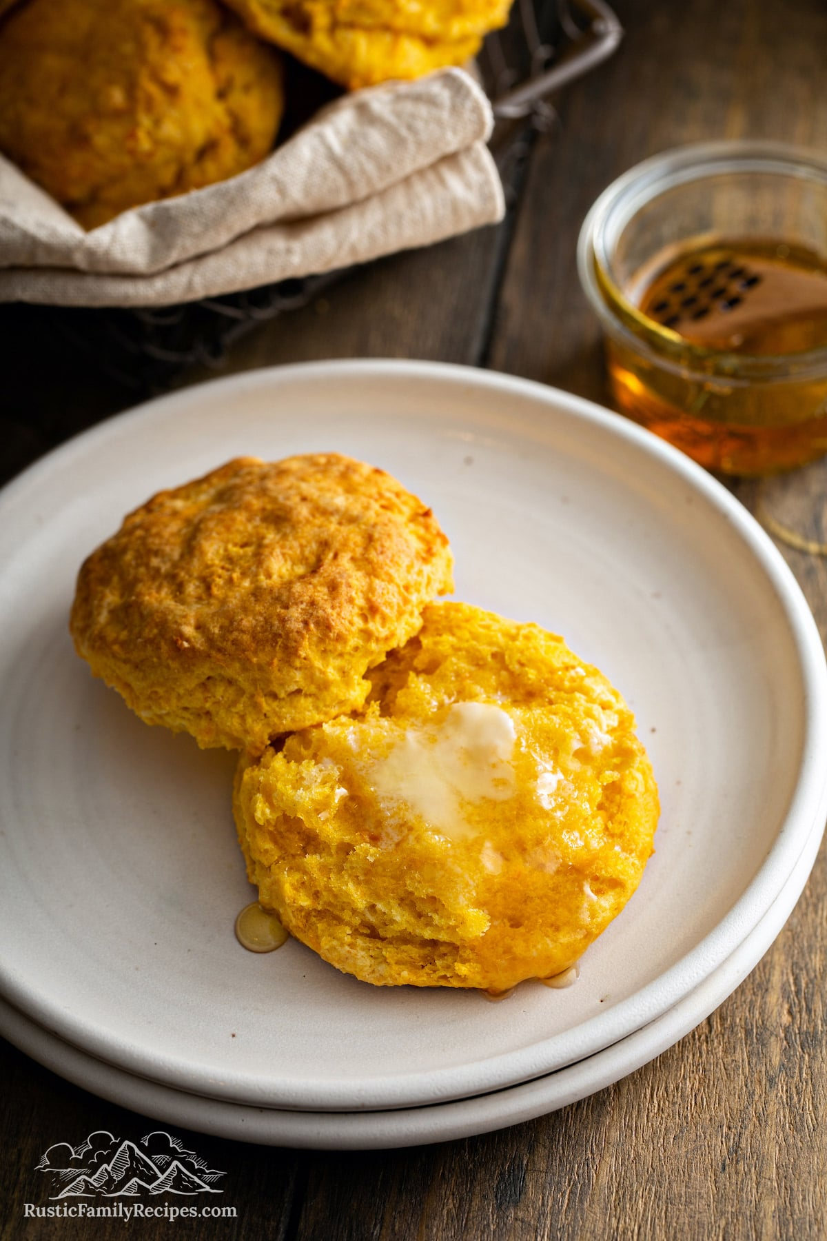 Sweet Potato Buttermilk Biscuit cut in half, topped with melted butter