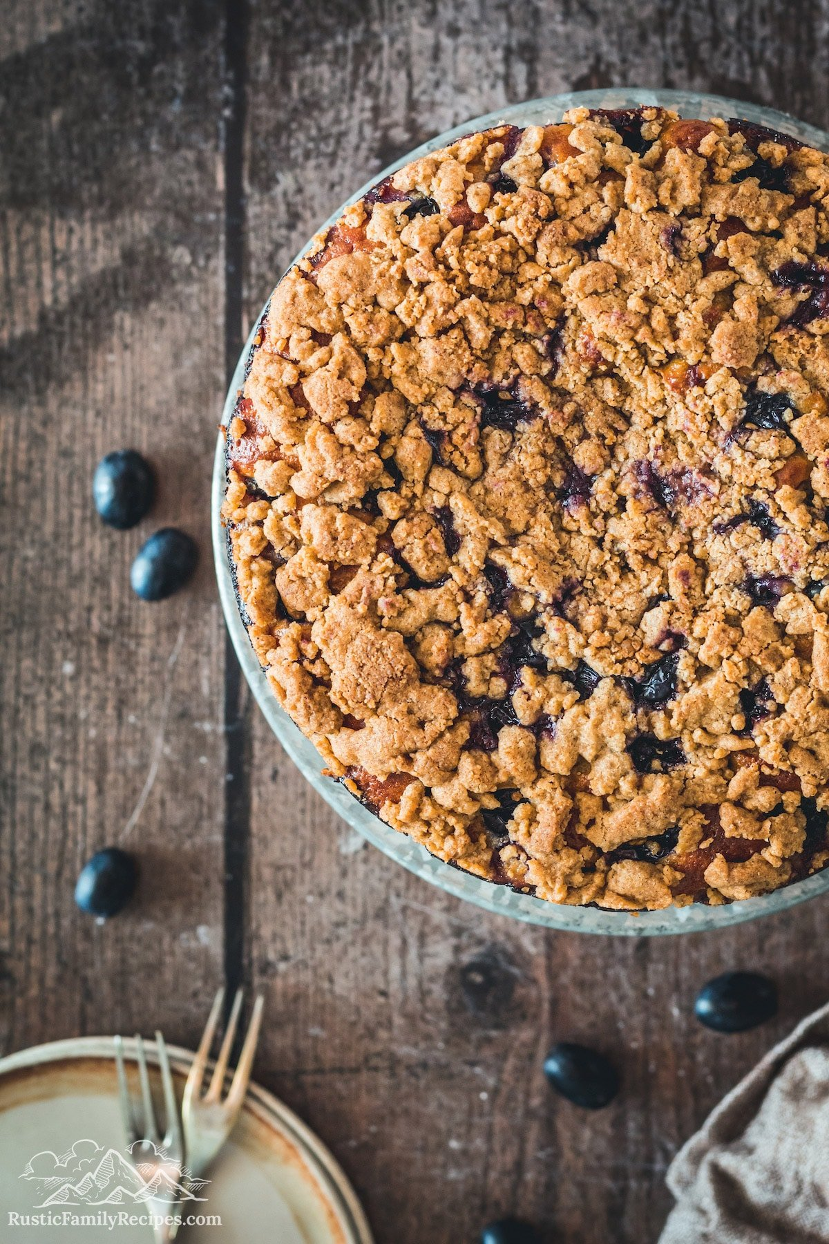 Top view of a black currant cake with streusel topping