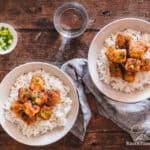 Overhead shot of two bowls of Orange Tofu