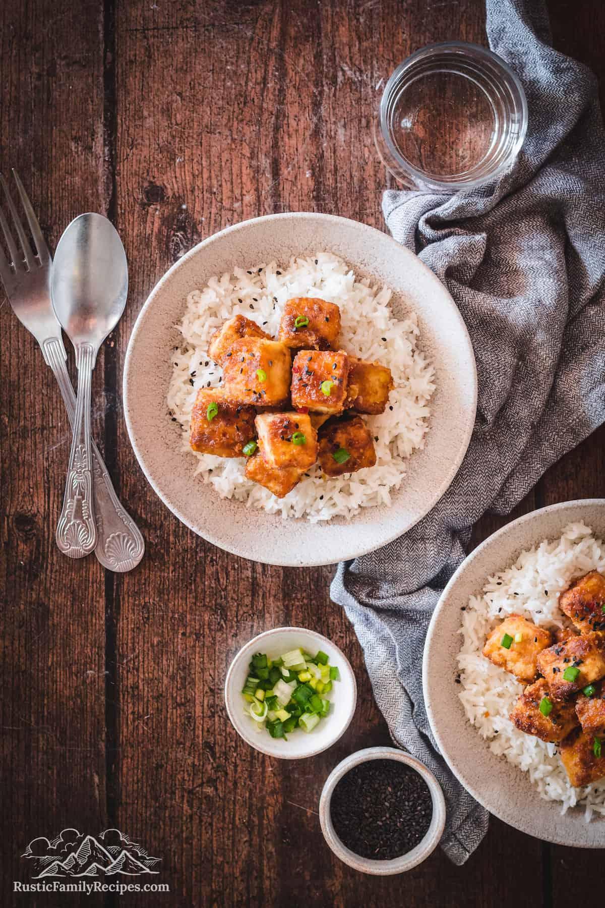Overhead shot of Orange Tofu recipe in white bowl with rice