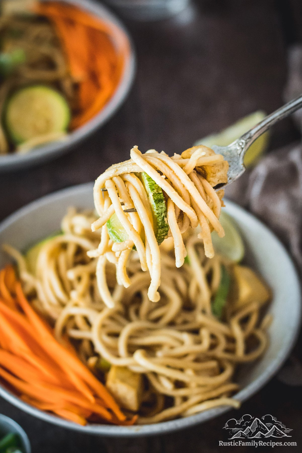 Peanut Noodles and zucchini on fork