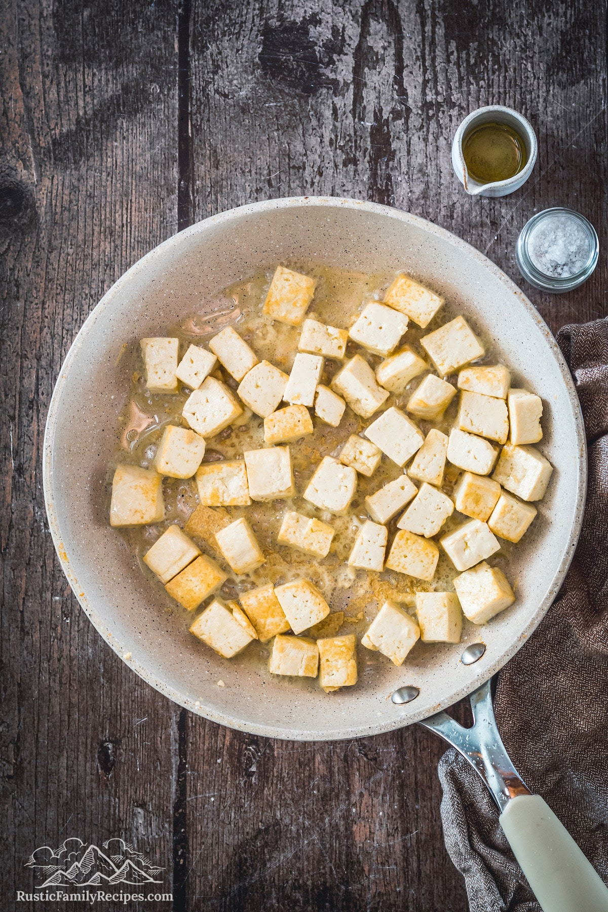 Overhead shot of tofu cubes in skillet