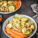 Two Peanut Noodle bowls with small bowl of scallions in foreground