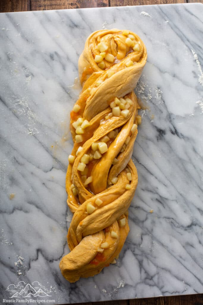 Pumpkin Apple Apricot Bread dough on marble baking slab