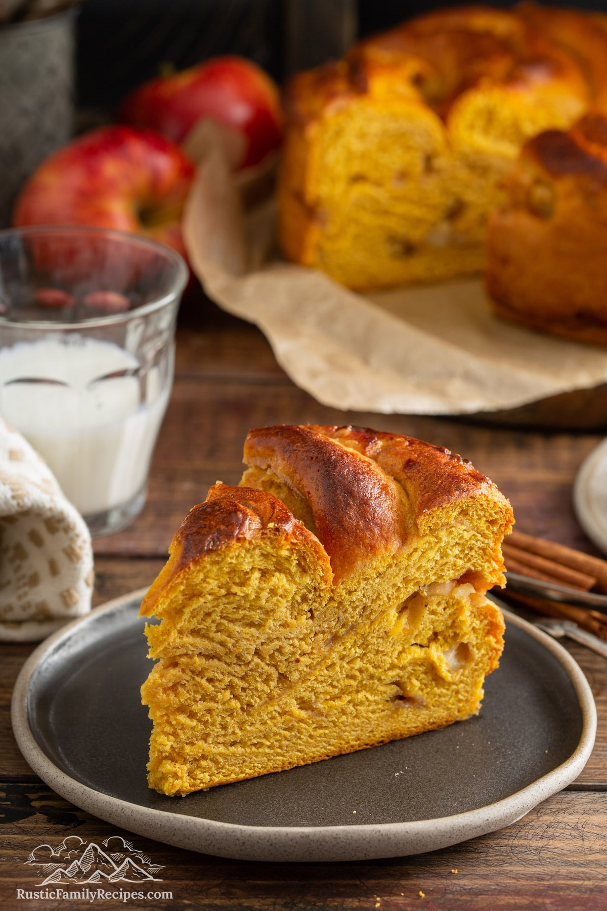 Slice of Pumpkin Apple Apricot Bread on rustic gray plate