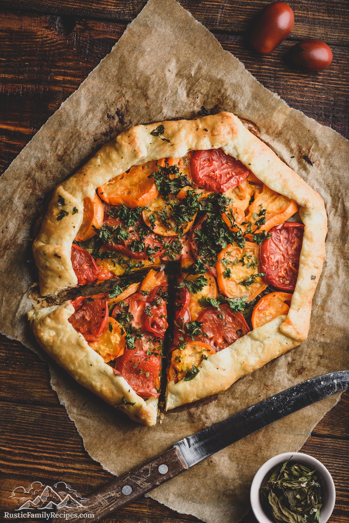 Rustic tomato galette with a slice taken out