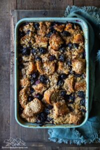 Blue casserole dish with blueberry french toast