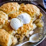 Apple cobbler in a pie pan with ice cream