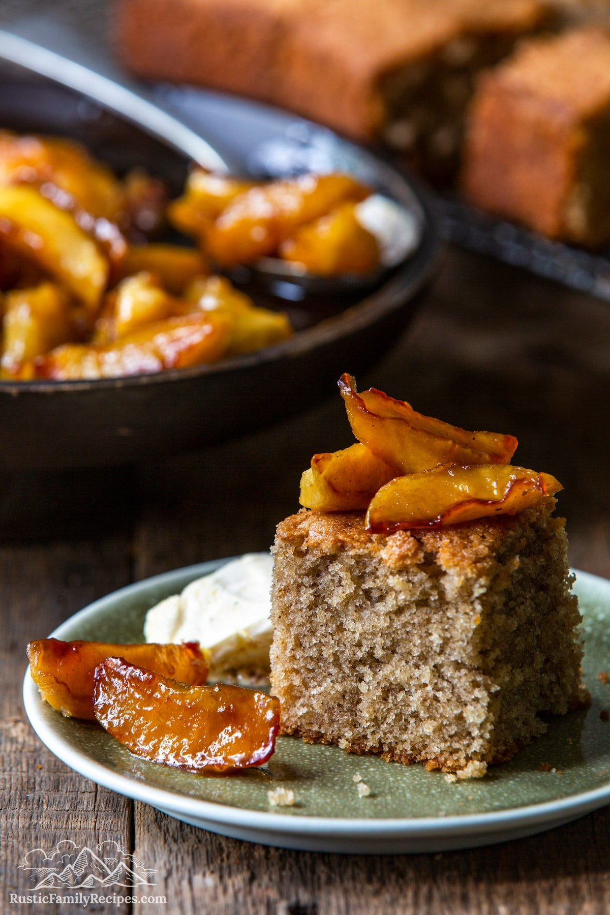 Spice Cake With Caramelized Apples on plate with skillet in background