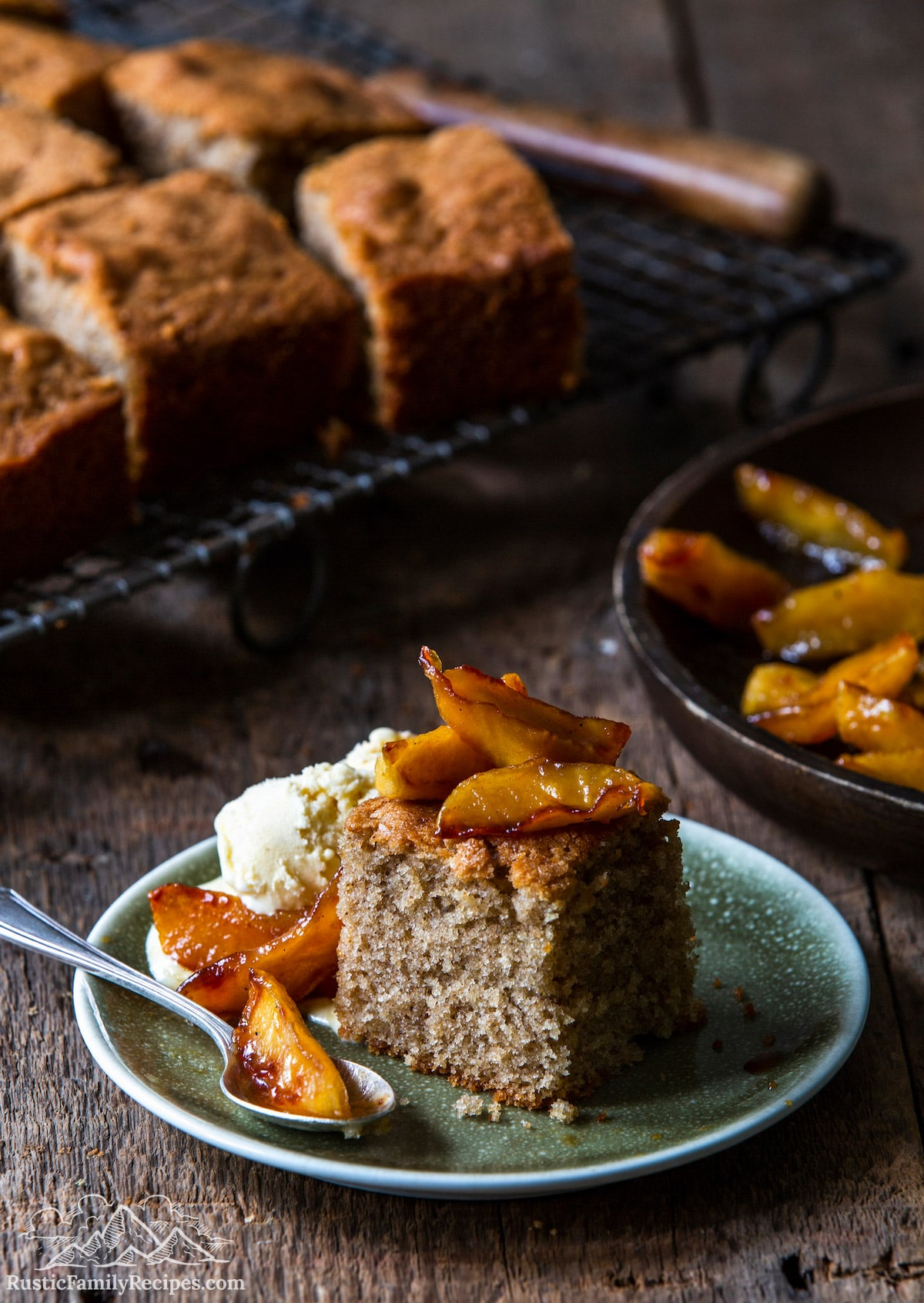 Spice Cake With Caramelized Apples on plate in front of wire rack