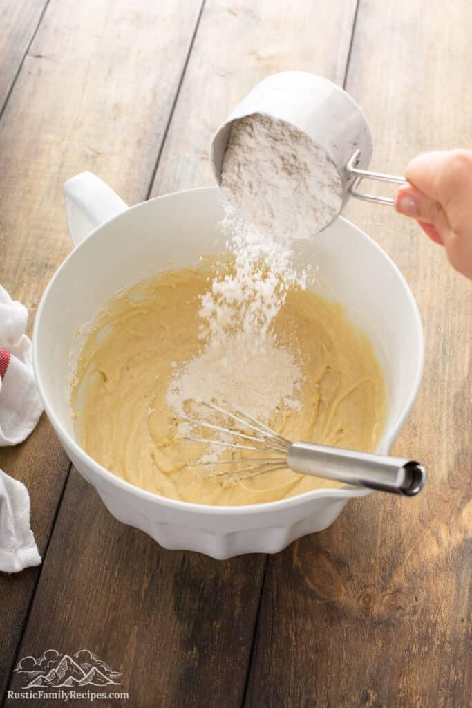 Pouring flour into Honey Vanilla Challah dough