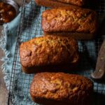 Mini apple zucchini breads cooling on a wire wrack