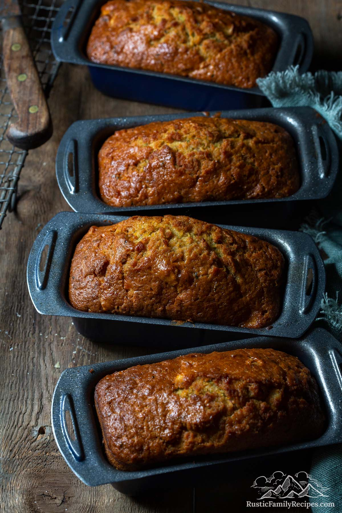 Loaves of mini zucchini breads in their baking tins