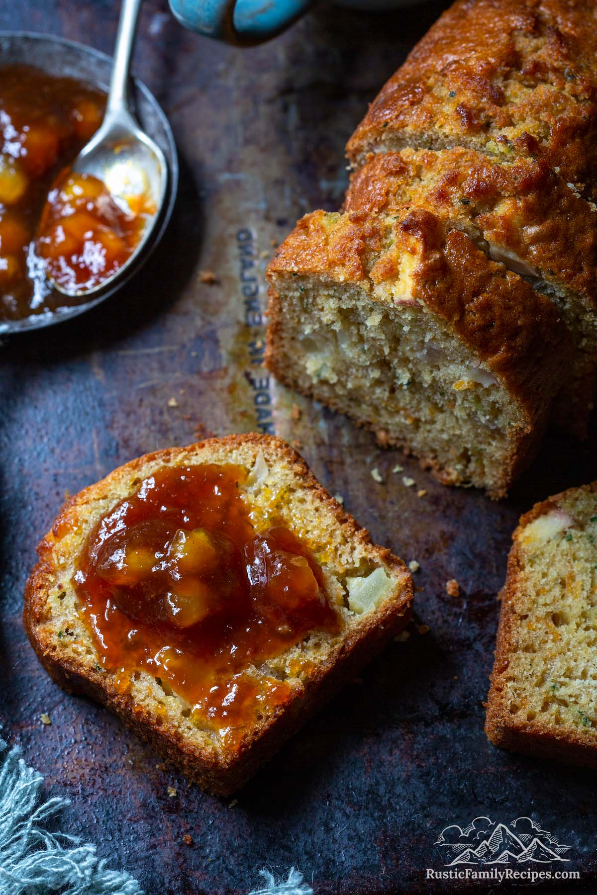Sliced apple carrot zucchini bread with apple butter
