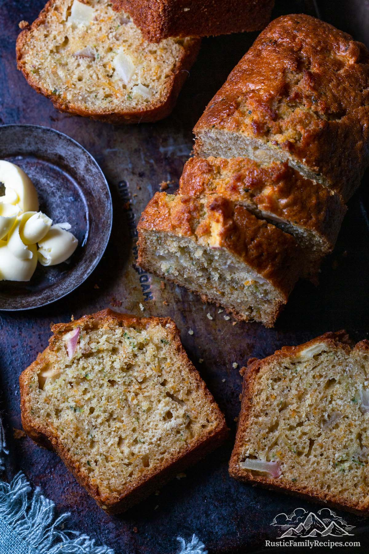 Sliced apple carrot zucchini bread with butter
